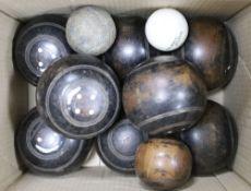 A set and a half of Lignum Vitae bowling woods