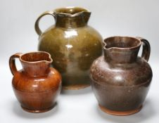 Three various 19th century Sussex terracotta flagons, largest 28cmCONDITION: Largest jug - some