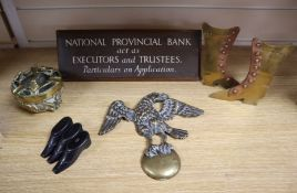 A set of three Victorian papier mache snuff boots, 8cm, a bank nameplate and ornamental brassware (