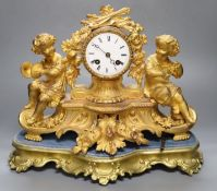 A 19th century French ormolu and gilt metal mantel clock, with musical youth surmount, Vincenti bell