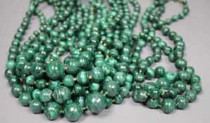 Ten assorted single strand malachite bead necklaces, two with gilt metal spacers, largest 64cm.