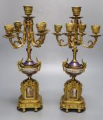 A pair of 19th century French ormulu and porcelain five light candelabra, mounts in the style of