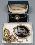Two Victorian gilt metal brooches, a similar locket pendant on chain and a lady's silver cased wrist