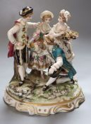 A German porcelain group, height 18cmCONDITION: Both ladies heads have been off and reglued. Several