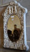 A late 19th century Dieppe ivory and bone mirror, width 52cm, height 82cm