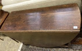 An 18th century oak oval topped gateleg dining table, fitted single drawer, width 130cm depth 50cm