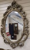 A Victorian style oval wall mirror, 90 x 136cm