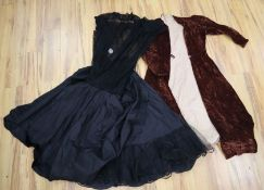 A black net 1950's evening dress petticoat and a quilted crushed velvet 1940's coat