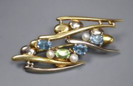 An early 1990's 18ct two colour gold and gem set modernist brooch, 5cm, gross 11.7 grams.