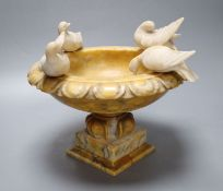 An Italian alabaster 'Doves of Pliny' urn, 26cm diameter