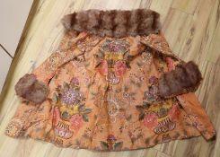 A 1930's orange brocade floral fur trimmed coat label Delia, 99 New Bond Street
