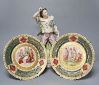 A 19th century French bisque figure, 32cm and two Vienna-style wall plates, 22cm