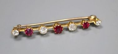 A yellow metal, four stone diamond and three stone ruby set bar brooch, 41mm, gross 3.6 grams.