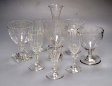 A group of four mid 19th century glass rummers, various cut glass champagne flutes etc.CONDITION: