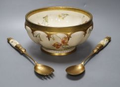 A late Victorian Royal Worcester ivory porcelain salad bowl and servers, with gilt metal mounts,