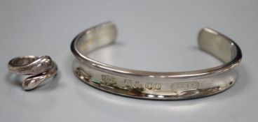 A modern Tiffany and Co 925 snake ring, size M and a Tiffany & Co 925 bangle, both with pouch and