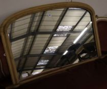 A late Victorian pine overmantel mirror, width 112cm height 65cm