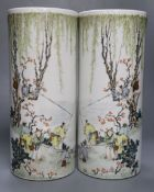 A pair of Chinese cylindrical porcelain vases, enamelled with fisherfolk, 29cmCONDITION: Good