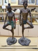 A pair of South African bronze figures, height 95cm
