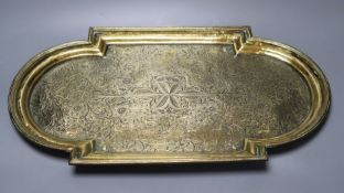 A 19th century Middle - Eastern engraved brass tray, 53cm wide