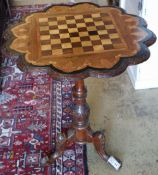 A Victorian carved walnut chess table, 60cm diameter, height 72cm