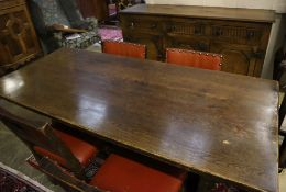 An 18th century-style oak refectory dining table, sideboard and four chairs, table 182 x 79cm height