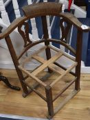 An early 20th century oak framed corner chair c.1900, inscribed 'This Chair is made from tree felled