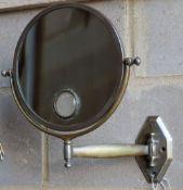 An Art Deco shaving mirror, plate 24cm diameter
