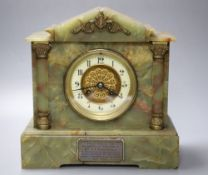 A late 19th century onyx cased eight day mantel clock, French gong-striking movement, presented