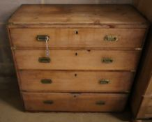 A Victorian pine chest of drawers having later brass mounts, width 90cm depth 44cm height 88cm