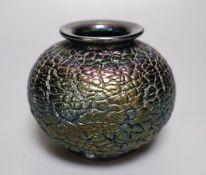 An iridescent black glass vase, squat globular form, 10cm