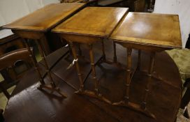 Three rectangular walnut occasional tables (formerly a nest of tables), largest width 50cm, depth