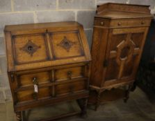 A 1920's panelled oak bureau, width 74cm, depth 46cm, height 103cm, together with a similar standing