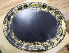 A Victorian oval papier mache tray, width 64cmCONDITION: Some chips around edge, clearly visible;