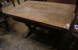 An Elizabethan style oak draw leaf extending dining table, 210cm extended width 80cm height 75cm