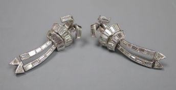 A pair of Art Deco style white metal, triangular and graduated baguette cut diamond set