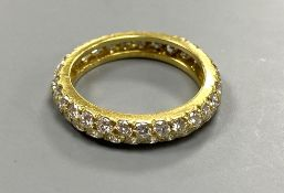 A modern Van Cleef & Arpels 750 yellow metal and two row diamond eternity ring, signed, size K,