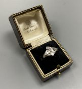 An unusual white metal (stamped Plat), triangular, square and graduated baguette cut diamond cluster