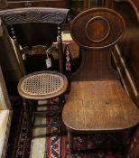 A Regency mahogany correction chair, a George III mahogany hall chair and two Victorian hall chairs