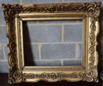 A Victorian carved giltwood and gesso picture frame, width 101cm height 87cm, aperture width 68 x
