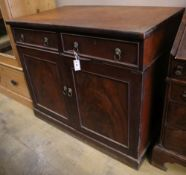 An early Victorian mahogany cabinet, fitted two drawers over panelled doors, width 114cm depth