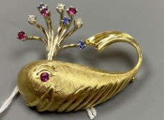 A novelty continental yellow metal (engraved 14k), ruby diamond and sapphire set 'happy' whale