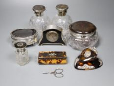 Eight assorted silver and tortoiseshell items including trinket box, scent bottles, timepiece and