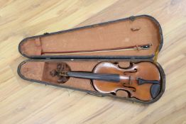 """A ate 19th century German violin labelled """"Heinrich Schwartz Leipzig 1894"""" cased with a bow"""