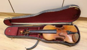 """An early 20th century violin, bears label """"Paolo Fiorini, Taurini 1928"""", cased with a bow, single-"""