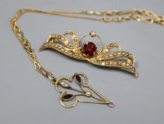 A 15ct, garnet and seed set brooch, 46mm, gross 4.3 grams and a 9ct pendant on a yellow metal