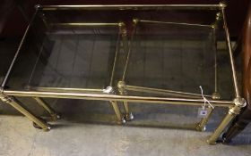 A nest of three brass and smoked glass tea tables, width 90cm depth 50cm height 44cm
