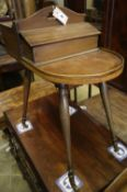A Victorian mahogany sewing table on slender splayed baluster legs with brass caps and castors,