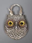 A modern white metal (stamped silver) and agate backed pendant, modelled as the head of an owl,