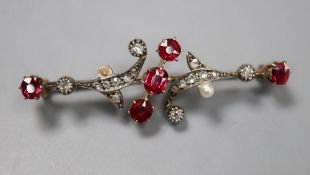 A yellow and white metal, ruby, diamond and seed pearl scrolling bar brooch (pearl missing), 46mm,